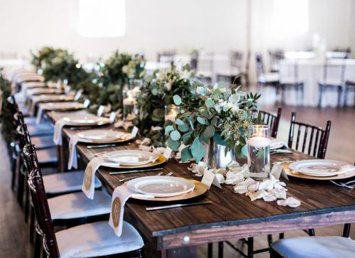 Elegant-wooden-and-greenery-wedding-reception-decor-at-Warehouse-Venue-in-Raleigh-Traine-Lindsay-Cash