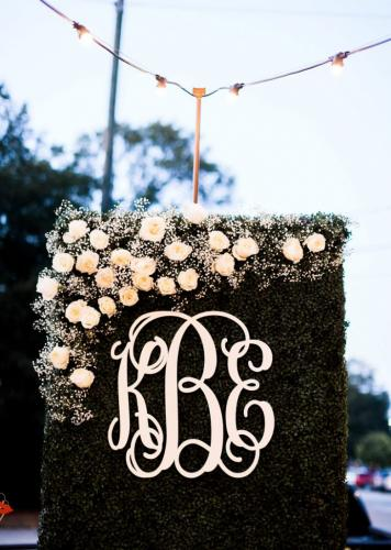 Large-Grass-wall-with-white-roses-and-monogram-as-wedding-reception-decoration-at-Traine-Lindsey-Cash-731x1024