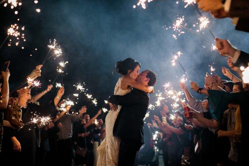 Sparkler-exit-kiss-at-Wedding-Venue-in-Raleigh-Traine-Lindsey-Cash